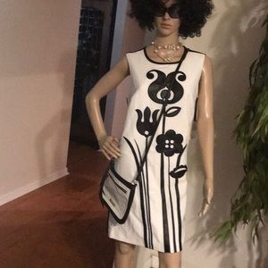 White dress with black leather deign
